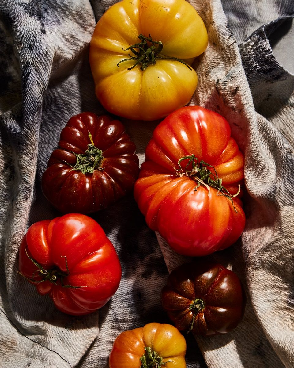 Large heirloom tomatoes on a table cloth
