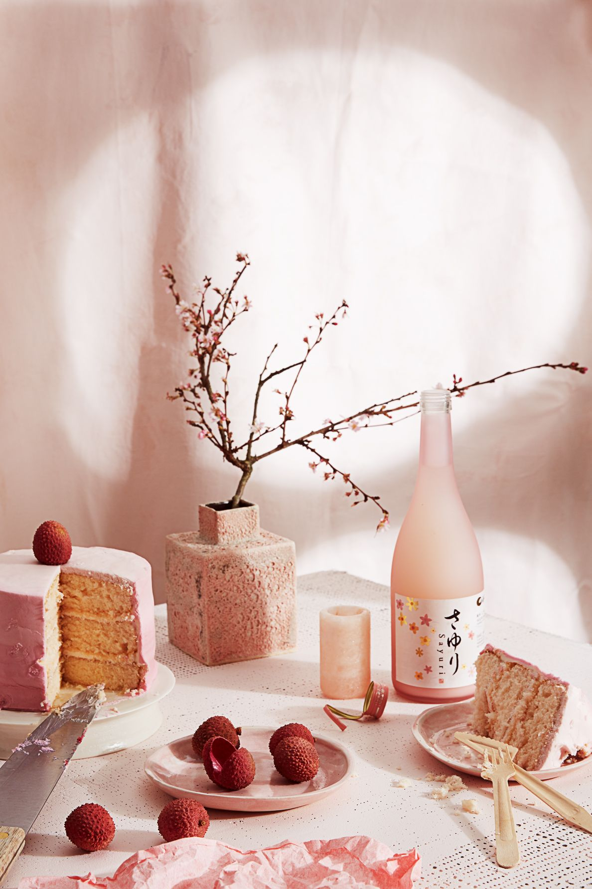 Pink sake and cake with berries