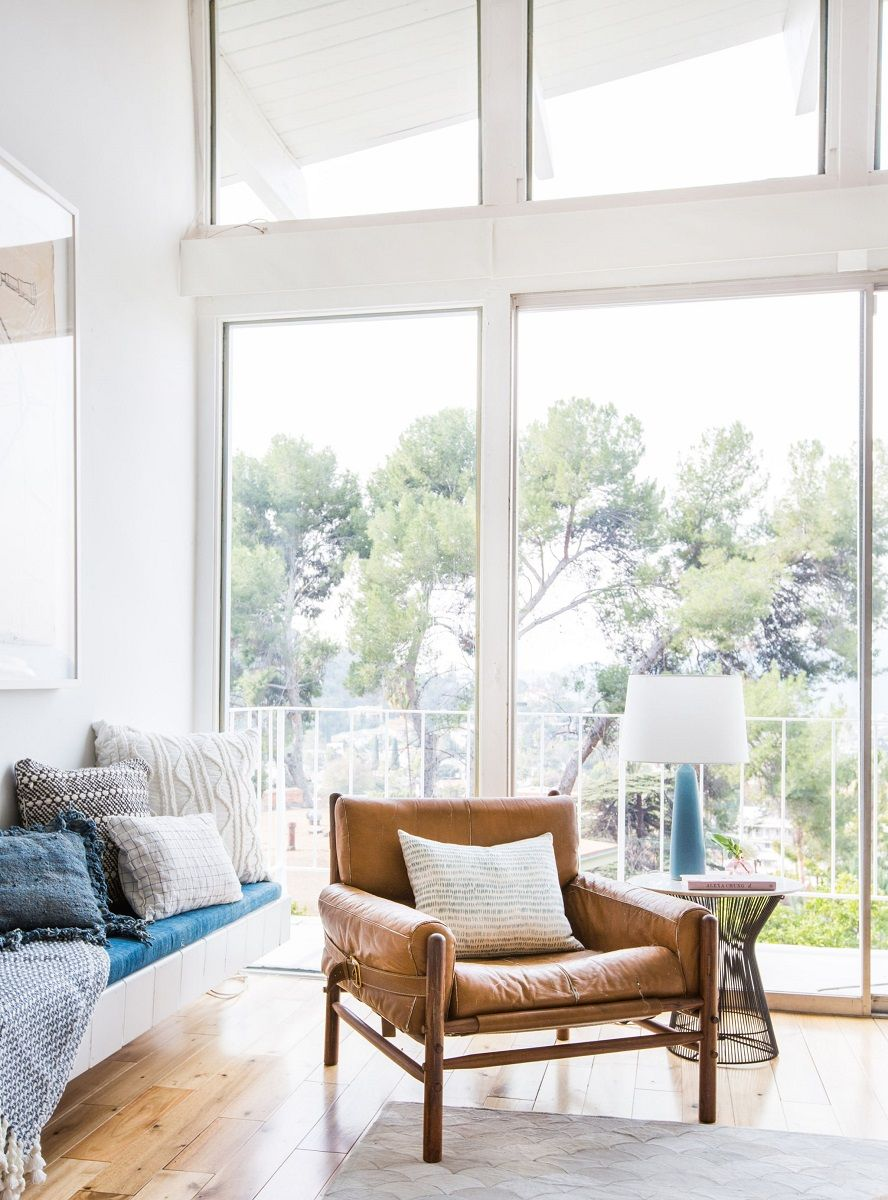 Emily-Henderson_Living-Room_Staged-To-Sell_Boho_Mid-Century_Eclectic_Blue_White_Styled_Couch_Sectional_Staged1-1024x1383@2x.jpg