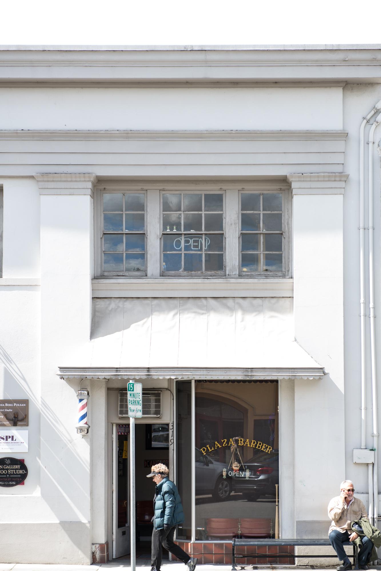 Plaza barber shop front white building