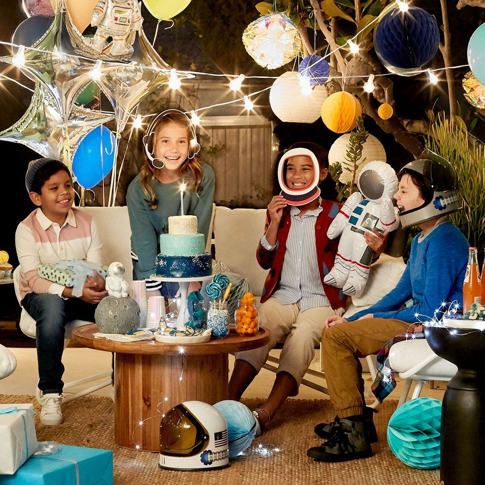 4 kids at a space themed party
