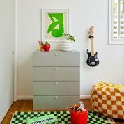 light green dress in kids room photography by george barberis