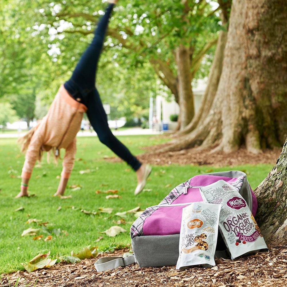 woman cartwheels in the park