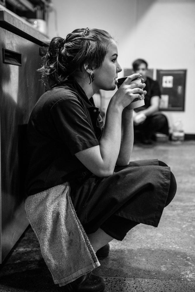 Girl kneeling drinking coffee