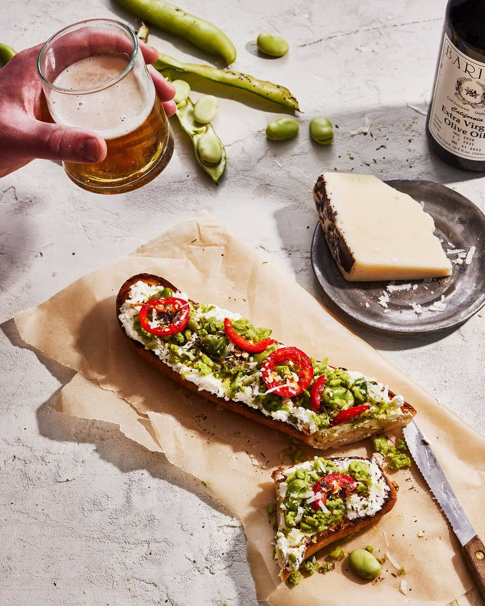 Grilled toast served with cheese and beer