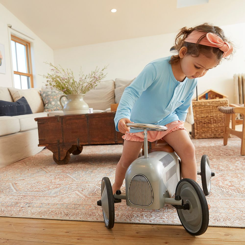 toddler on a toy car