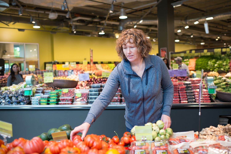Stylist Rachel Grunig Picks Tomatoes At Produce Stand