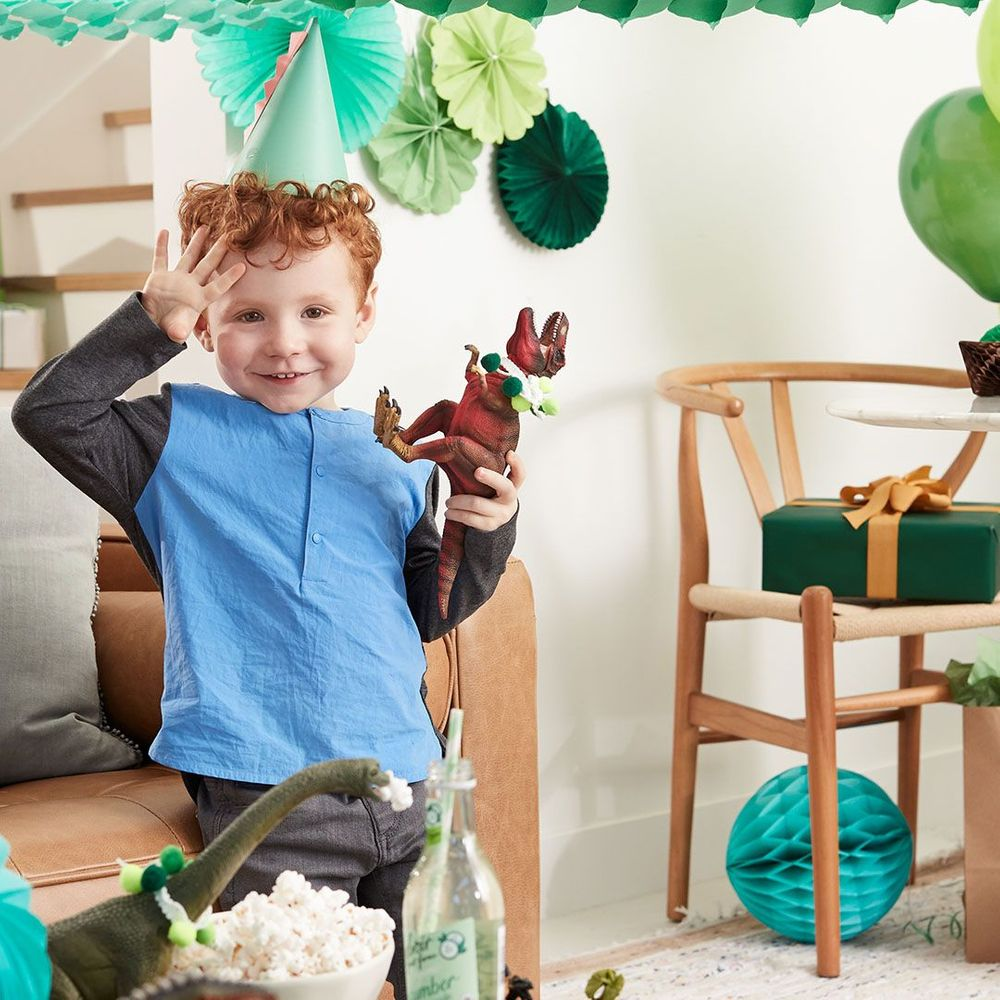 little boy in green party hat at birthday party