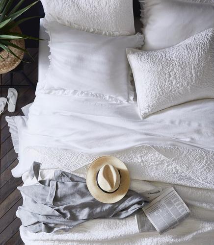 hat on bed.jpeg
