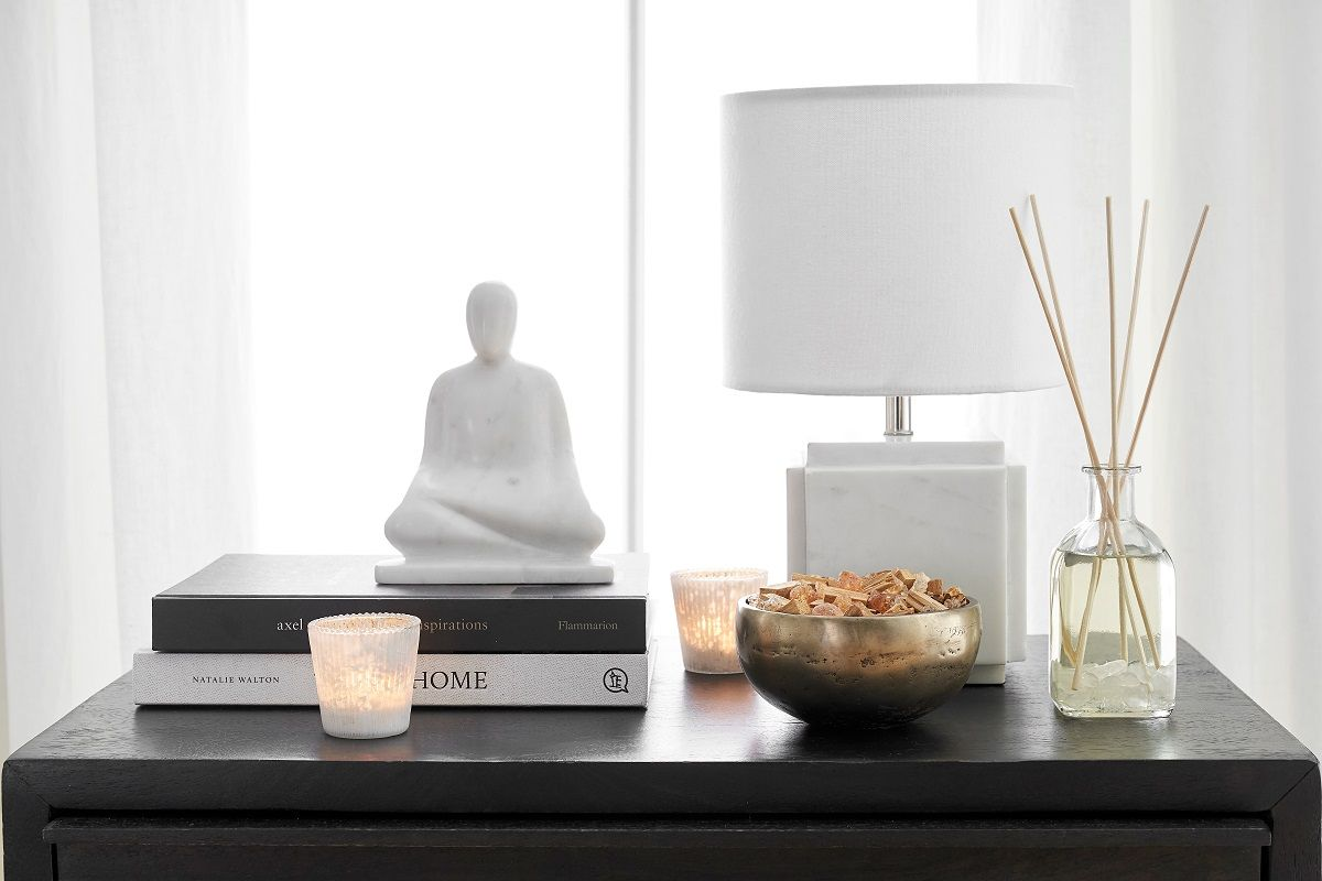 Buddha on side table with infuser