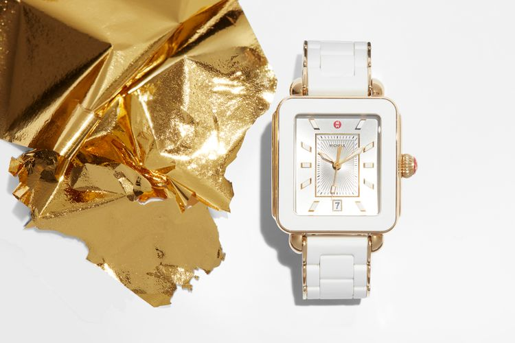 Gold and white watch product shot