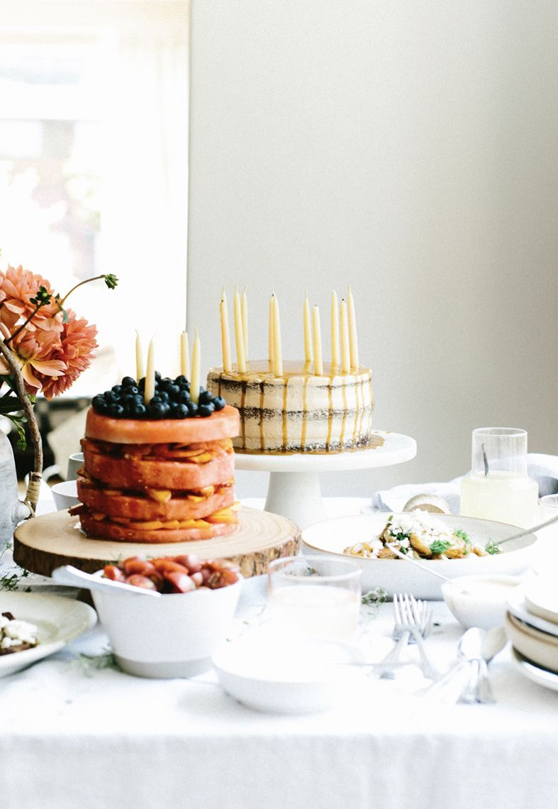 Layer cakes with candles tablescape