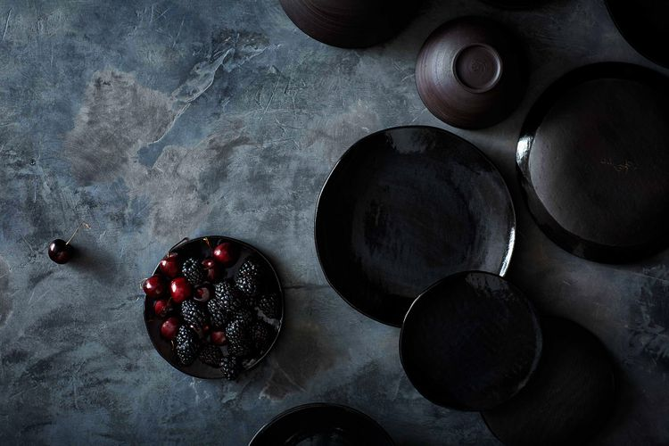 Dark pottery with berries