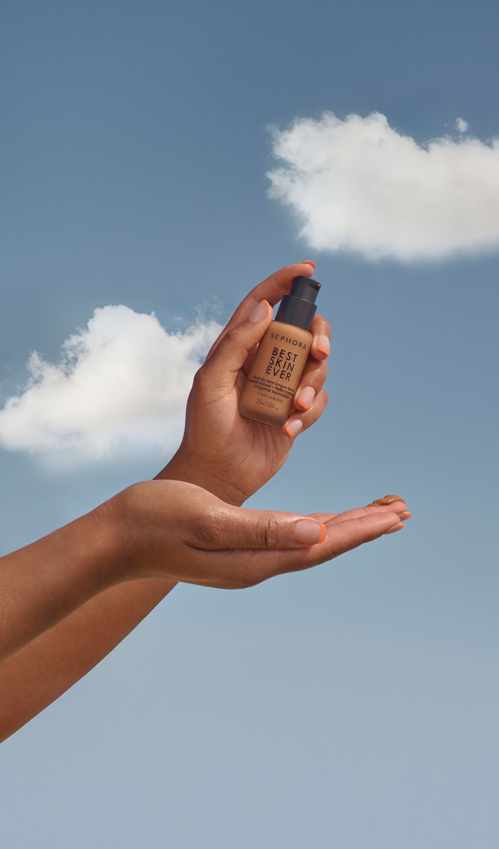 woman's hands hold make up bottle