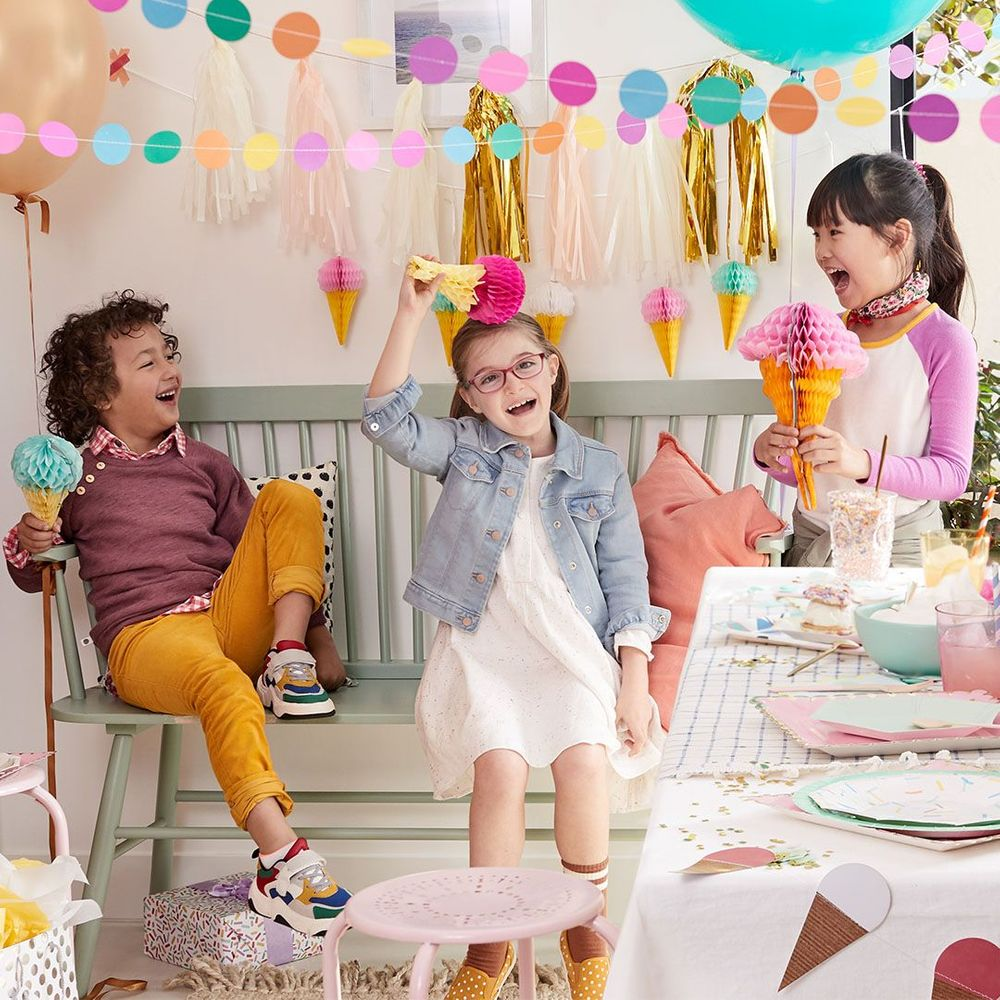 three kids laughing at a birthday party