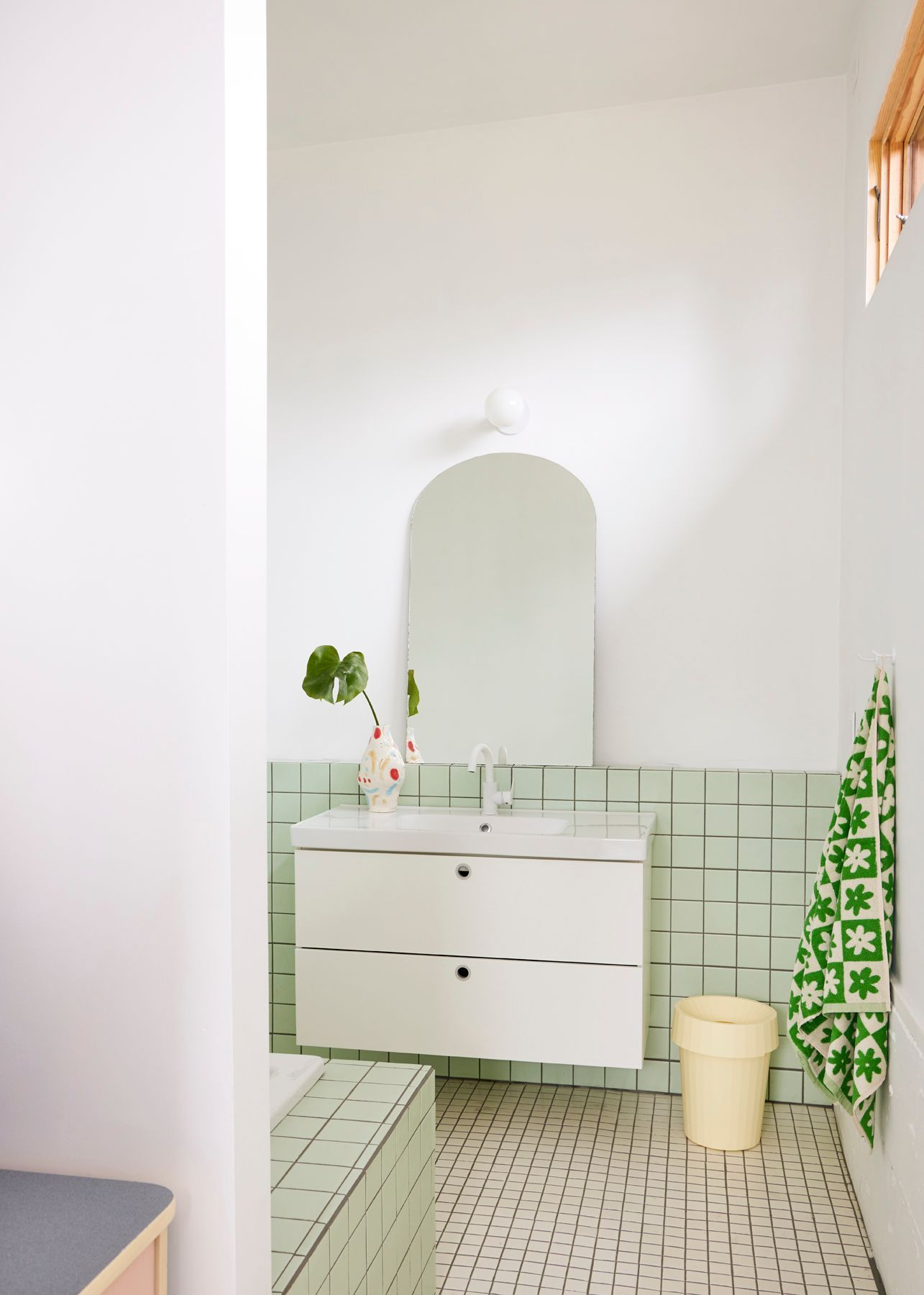 bathroom with green and white tile domino