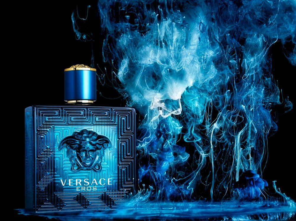 Blue ink in water dark moody ad for Versace fragrance