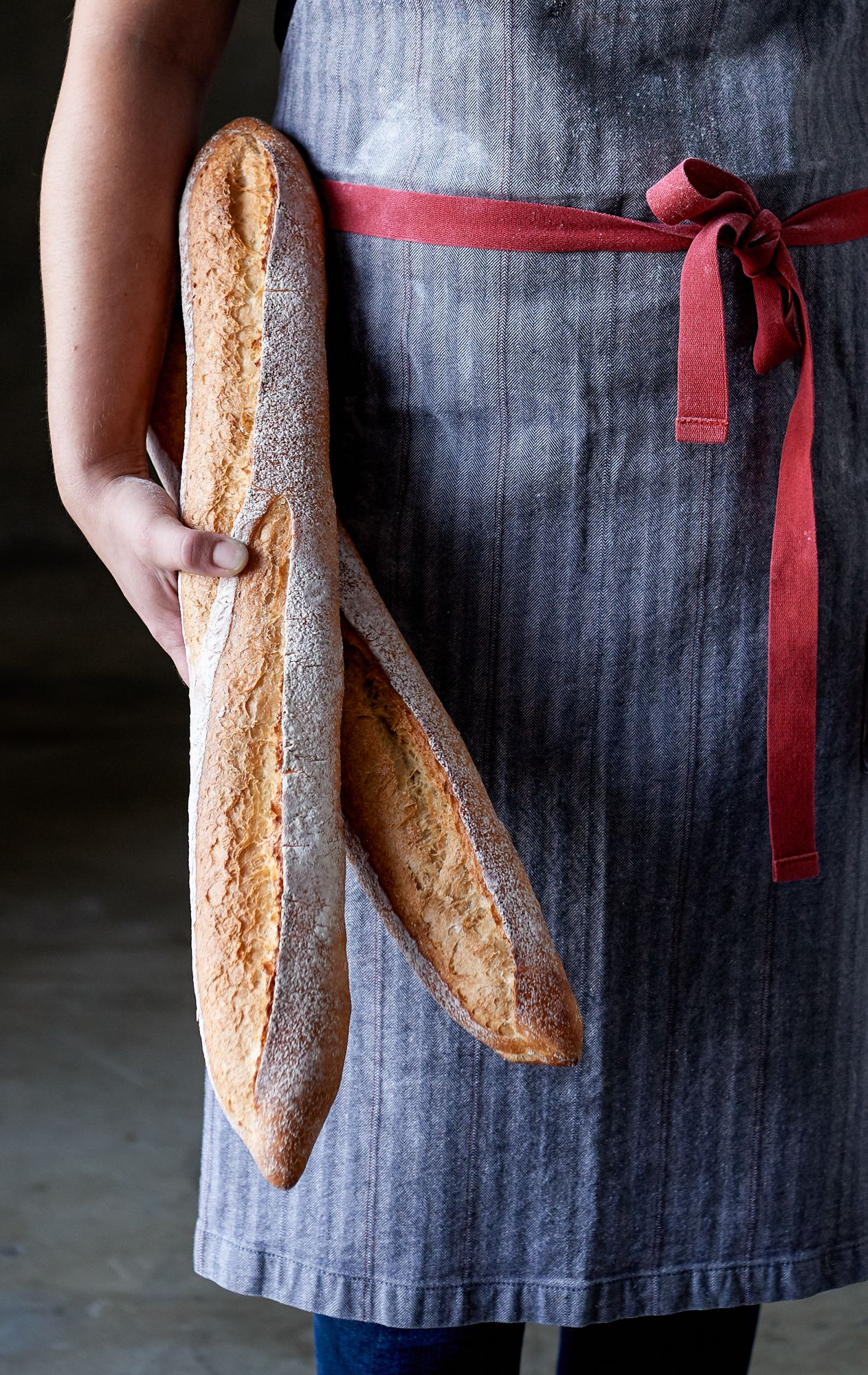 Hands Holding Fresh French Baguette Bread