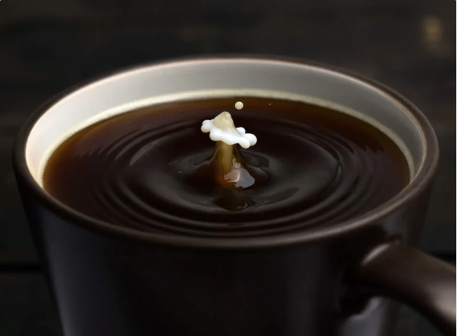 Coffee cup with a splash of milk shot for Nespresso by Mark Mawson, Photographer