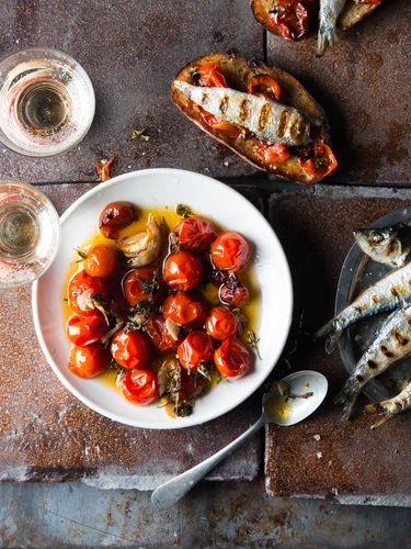 Tomatoes oil grilled fish bruscetta