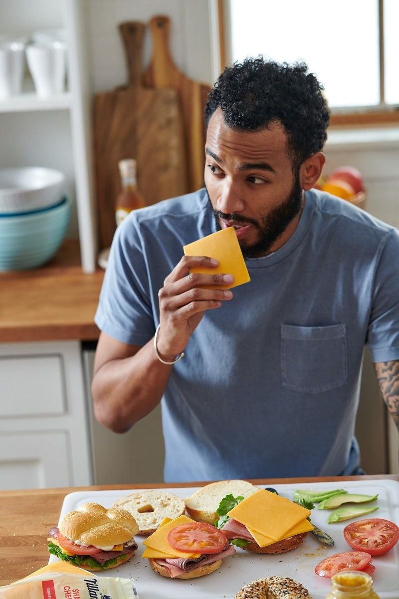 Hungry Man eating cheese