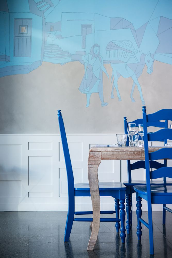 Blue chairs at wood table