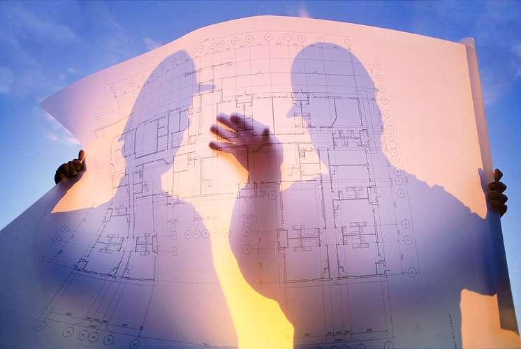 PORTFOLIO - People #21 Two Building Contractors Looking at Blueprints