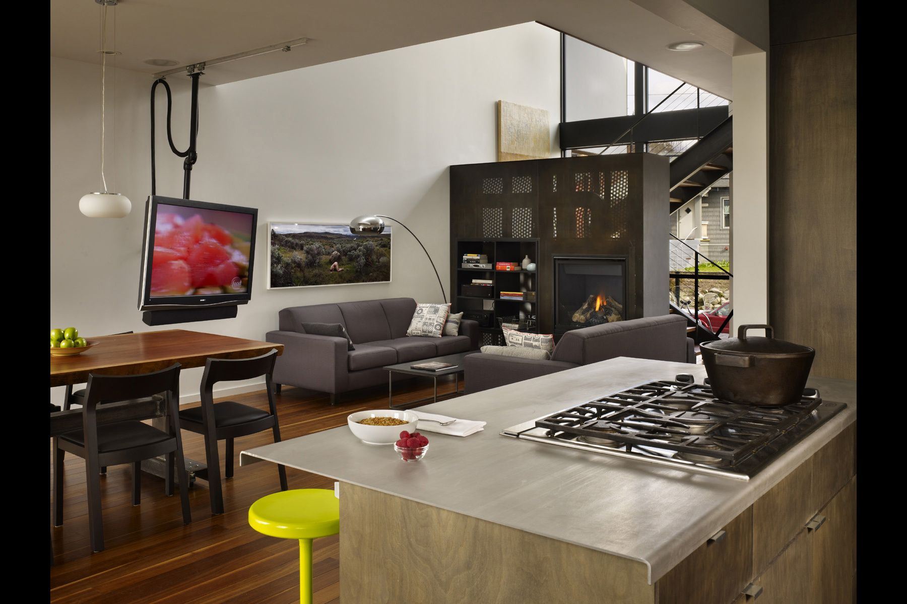 kitchen, custom tv mount, steel fireplace, open space
