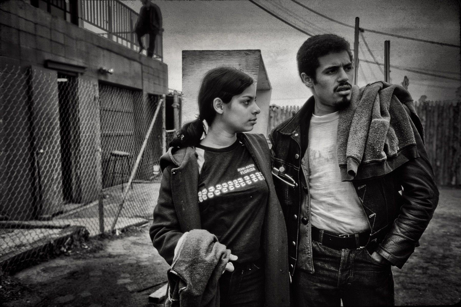 """Eddie Cuevas, president of the Reapers street gang, with his girlfriend Yvette."""