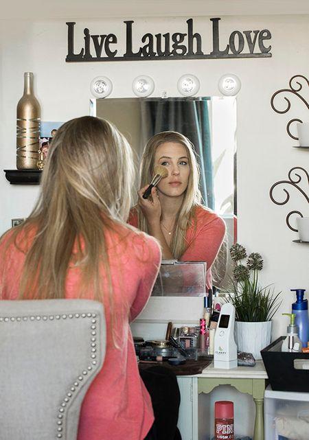 Emily puts on makeup