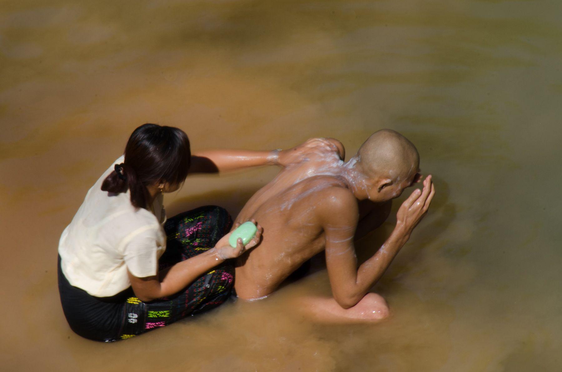 Woman bathing Monk, Peik Chin Myaung, Myanmar