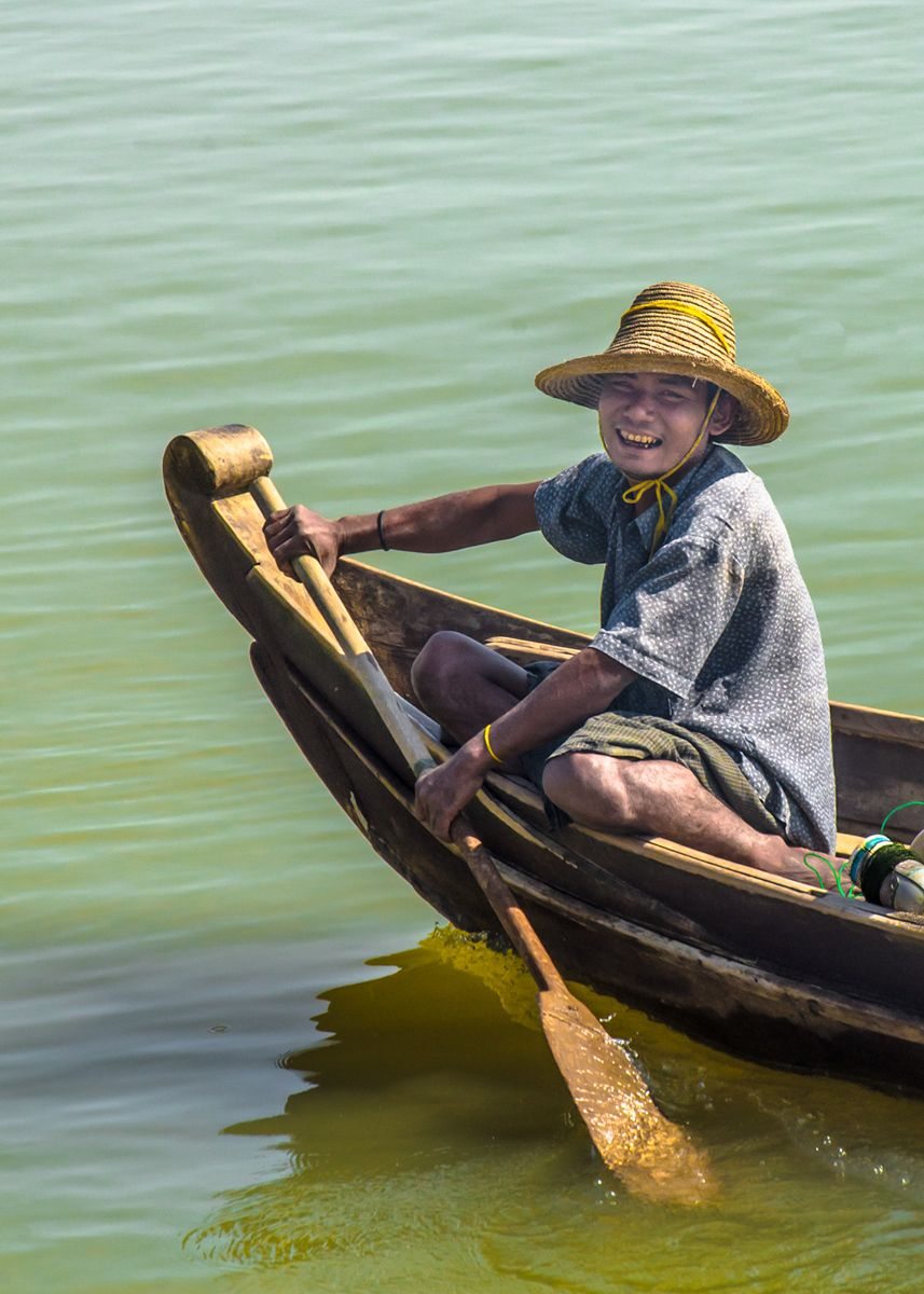 Boy rowing boat, Myanmar