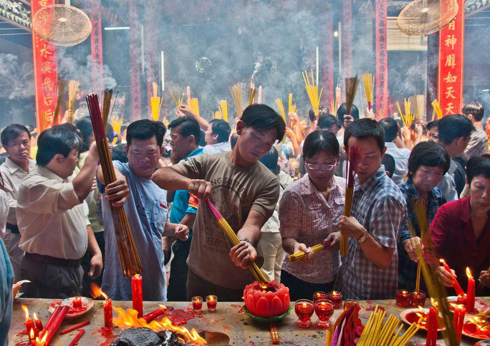 Incense Burning during Tet Festival, Buddhist Temple, Ho Chi Minh City, Vietnam