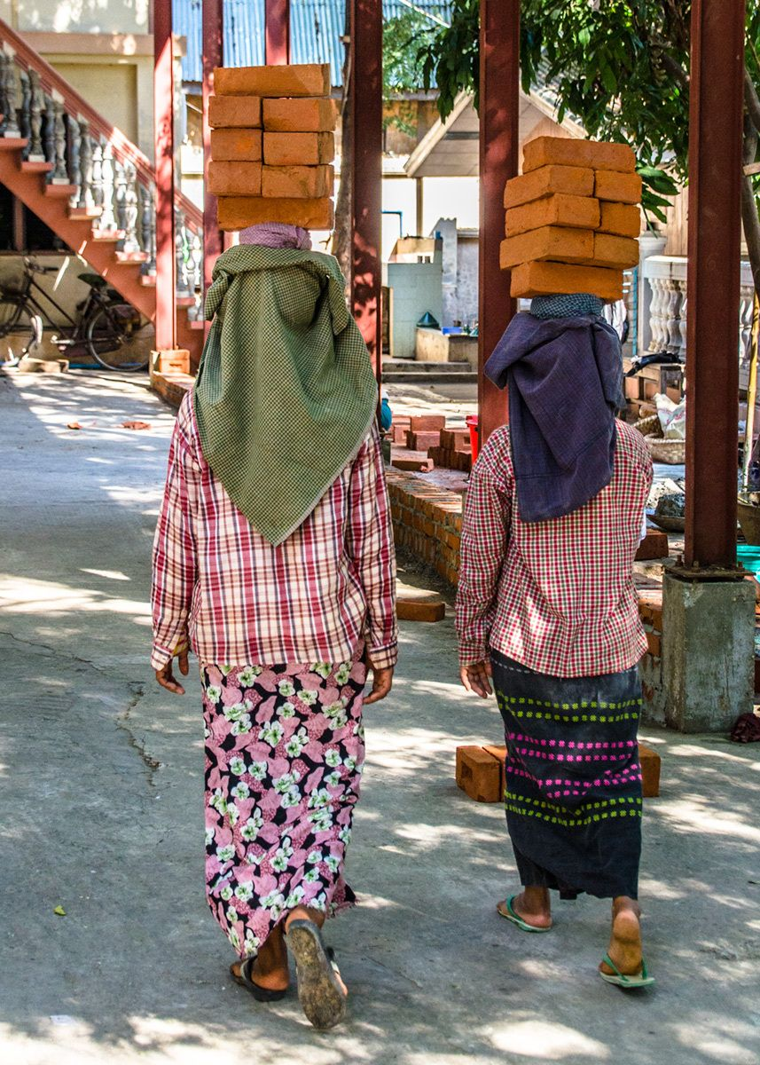 Women carrying bricks, Myanmar