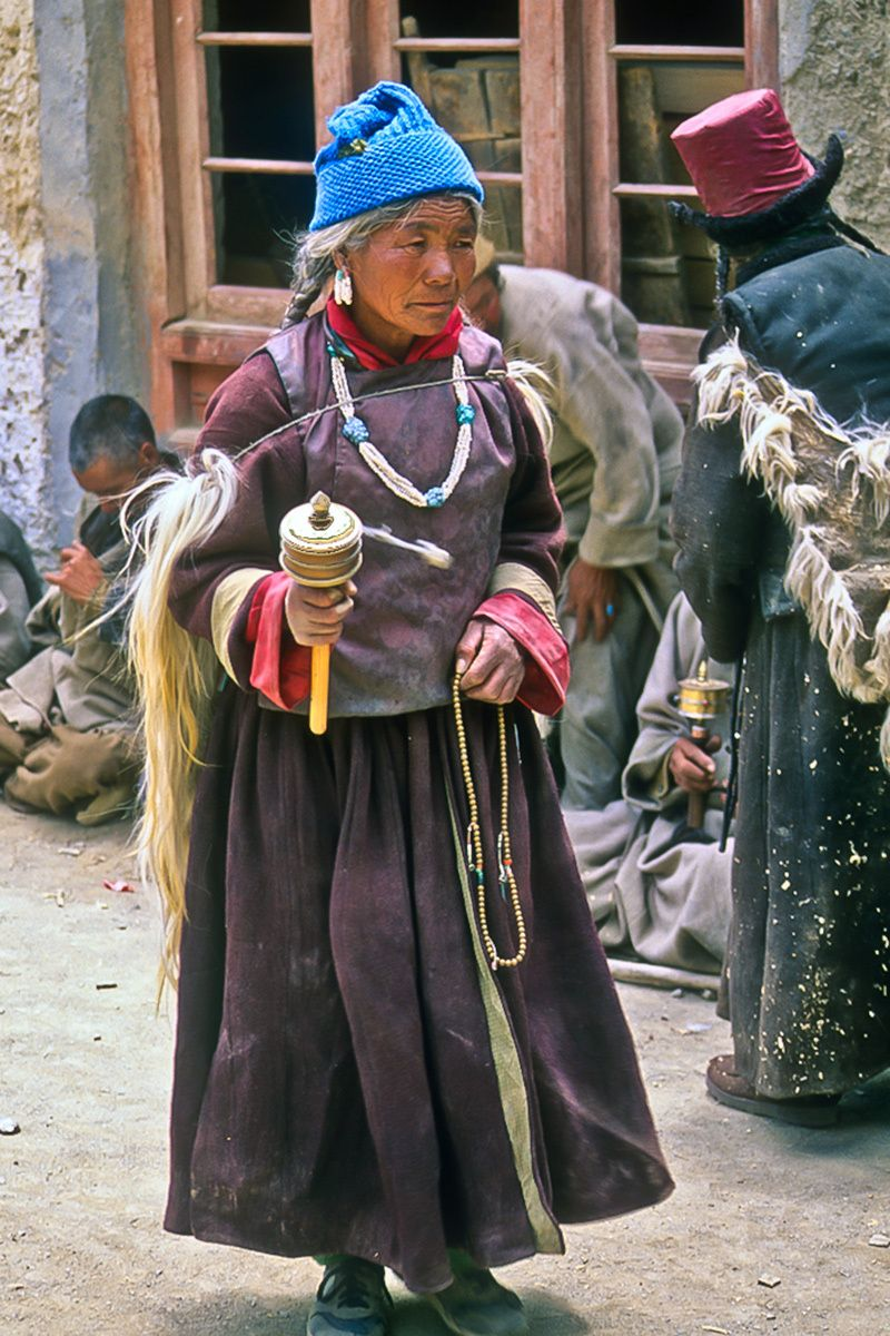 Indian Woman Spinning Prayer Wheel, Ladakh, India