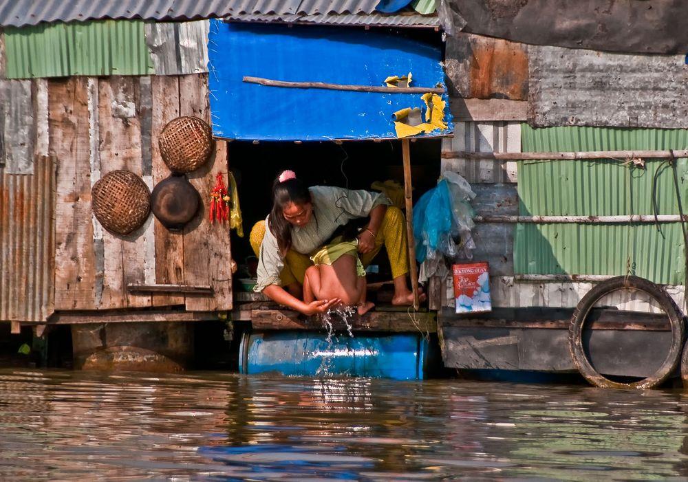 Mother bathing Child, Mekong Delta, Southern Vietnam