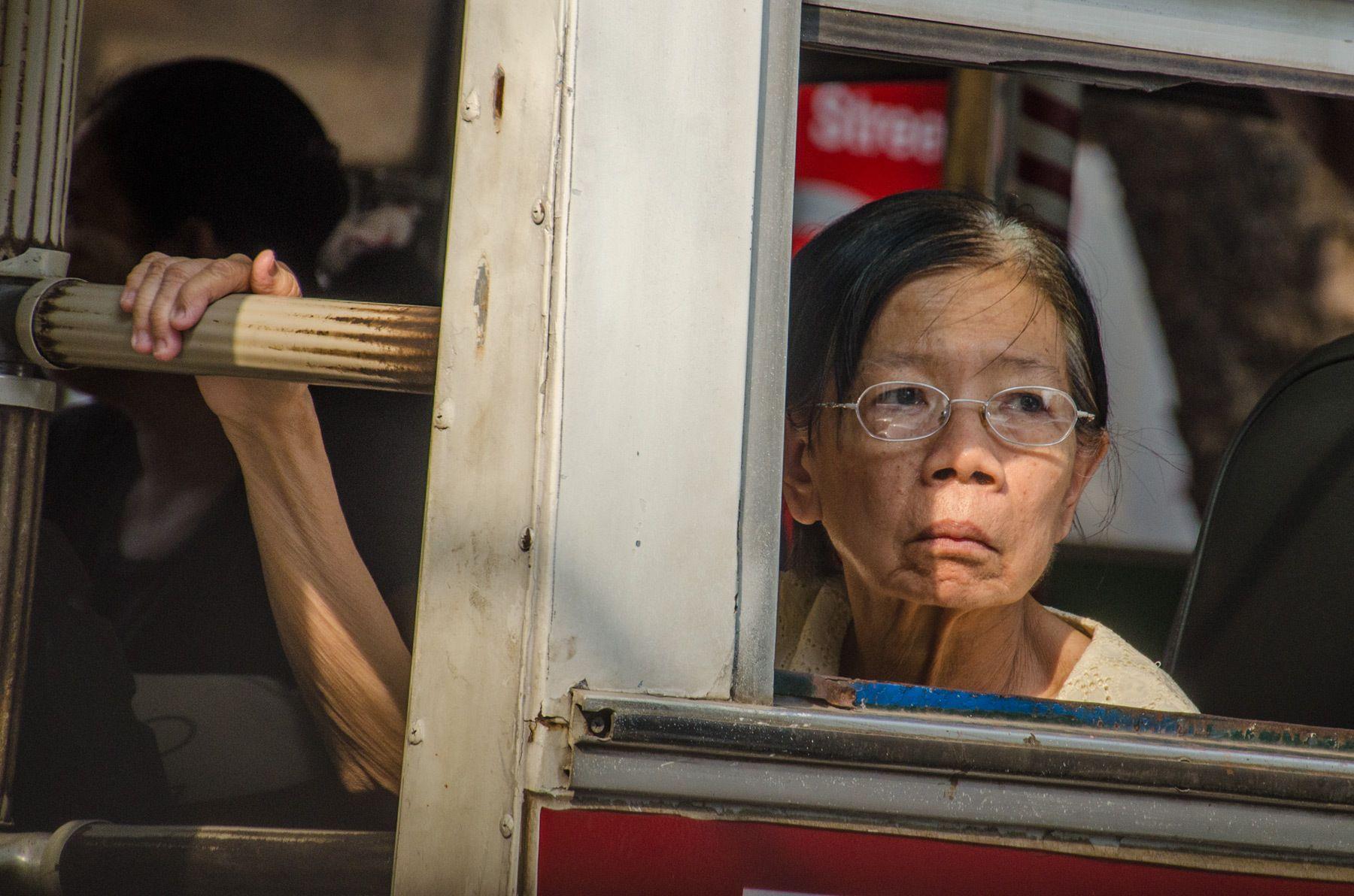 Woman riding the bus, Myanmar