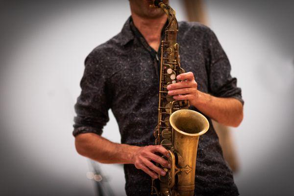 Saxophonist for Sam Reider