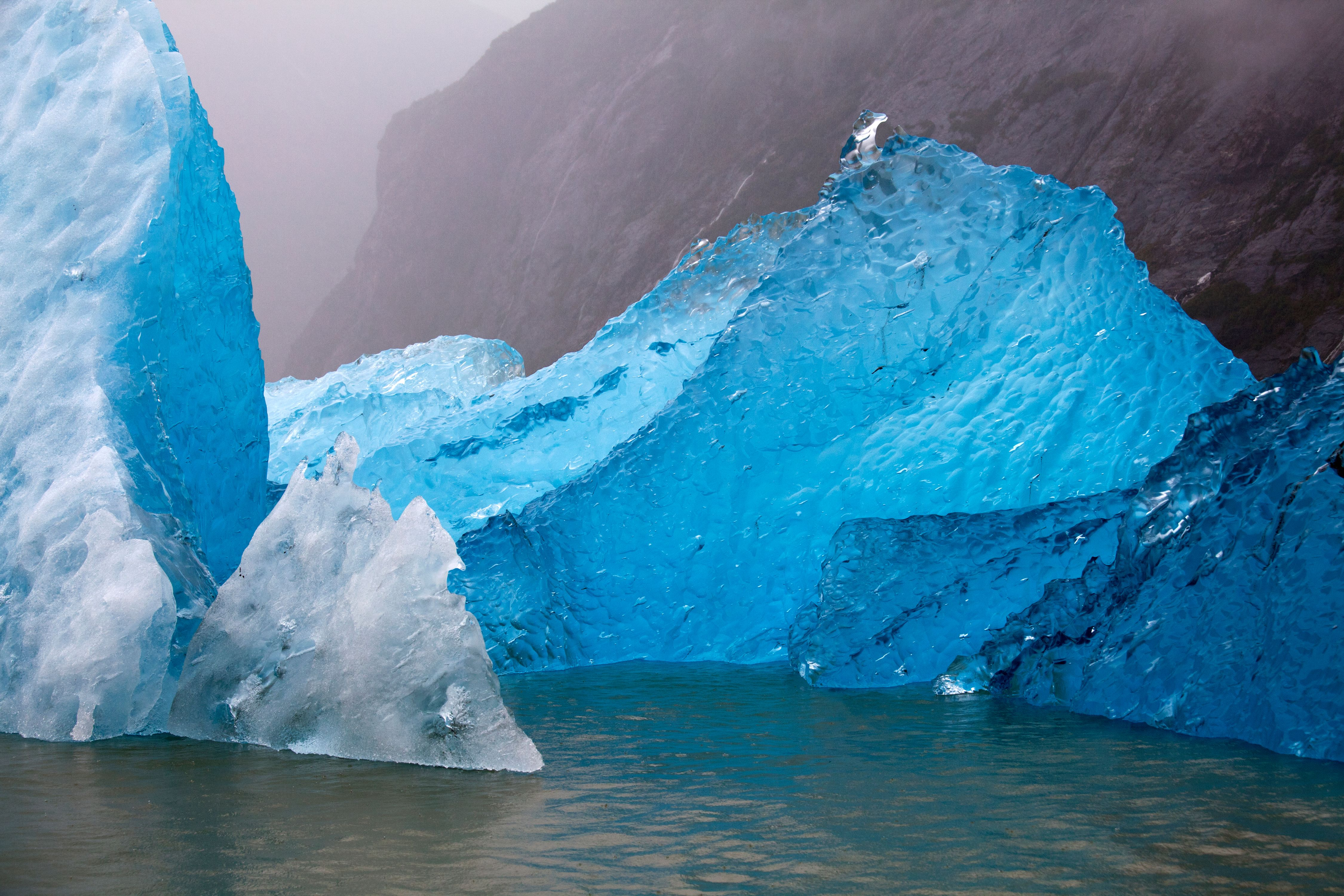 Frozen eons of water and time float away from their glacier onto the tide