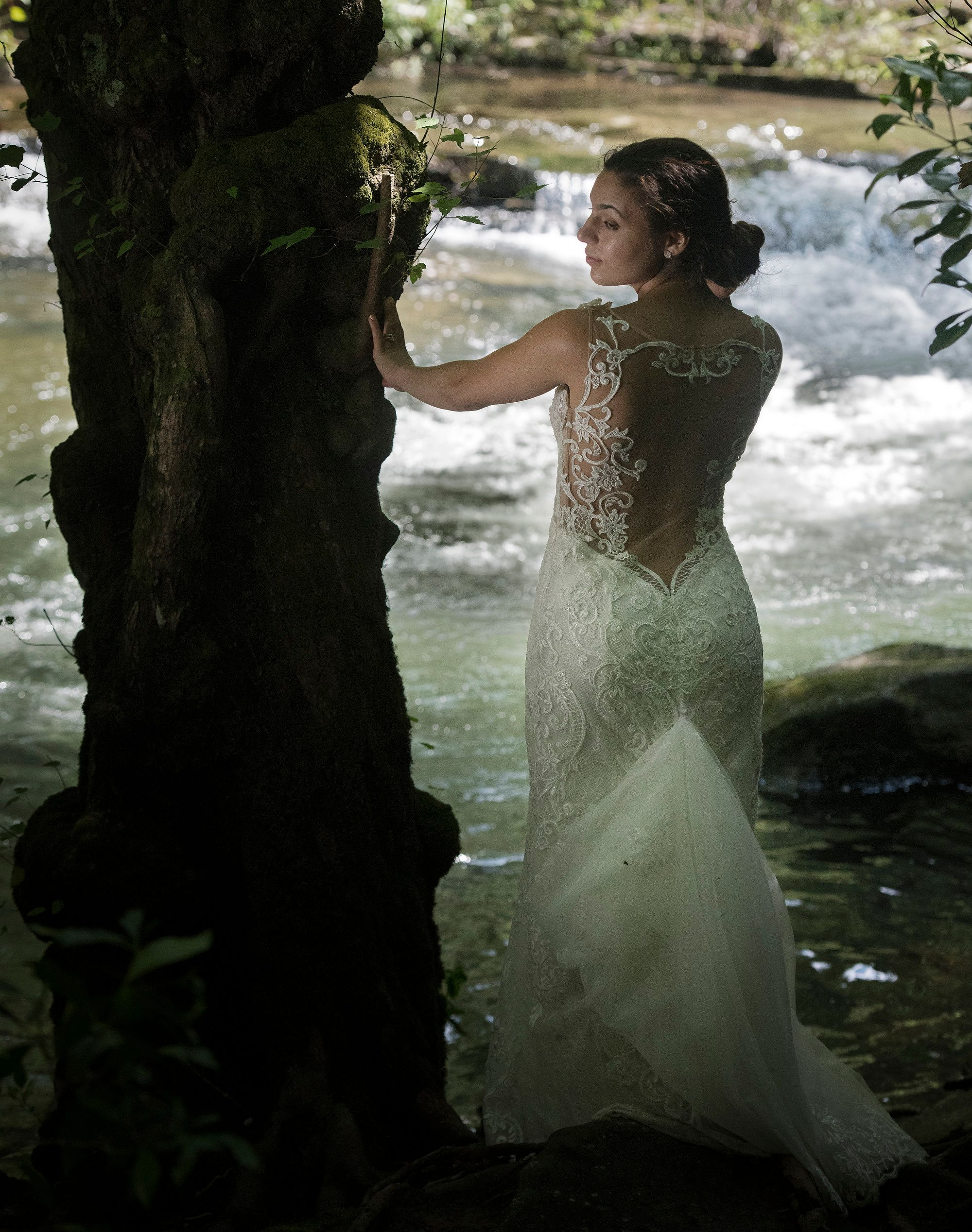 Elegant Bride By The Riverbank