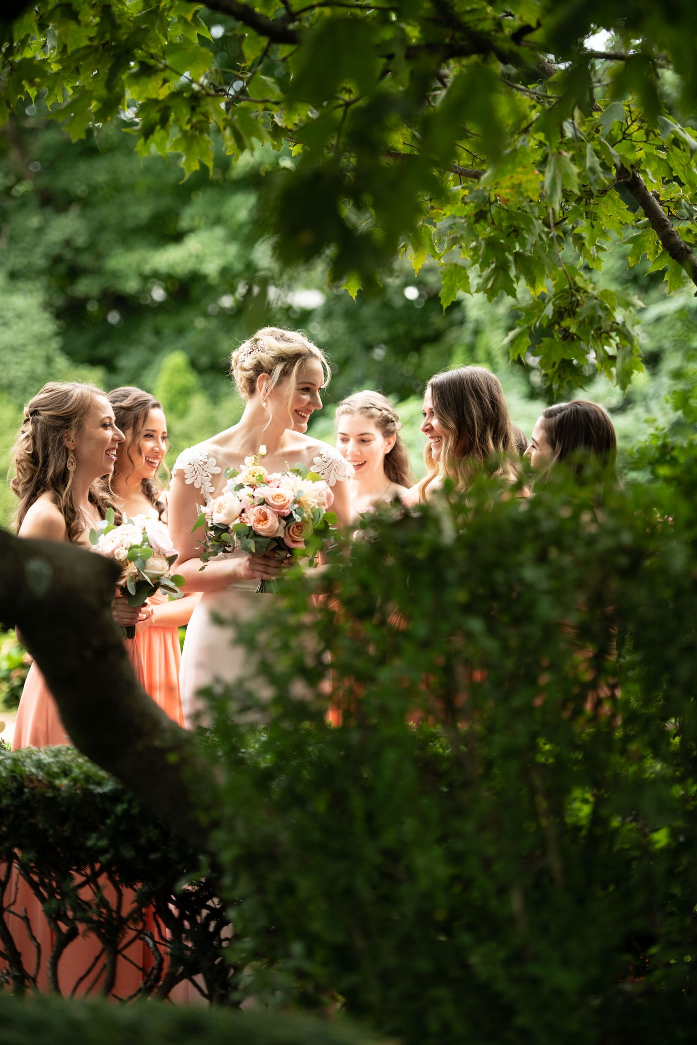 A Bride In The Garden With Her Bridesmaids