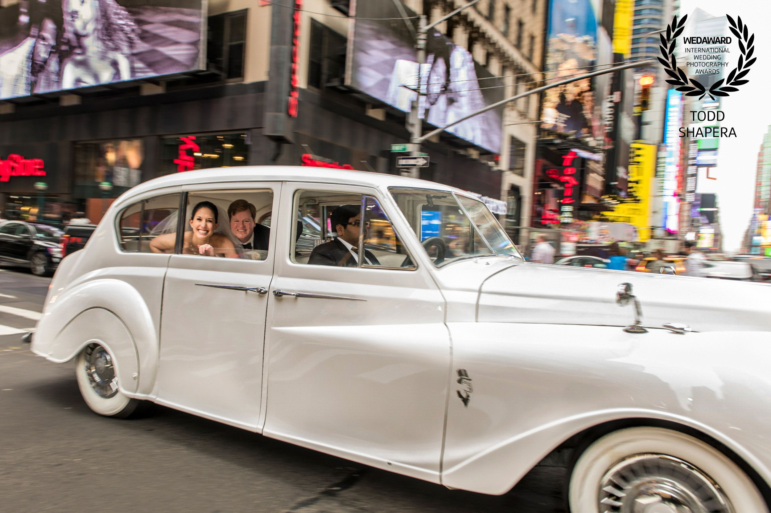A luxurious post-wedding Rolls Royce ride through New York City
