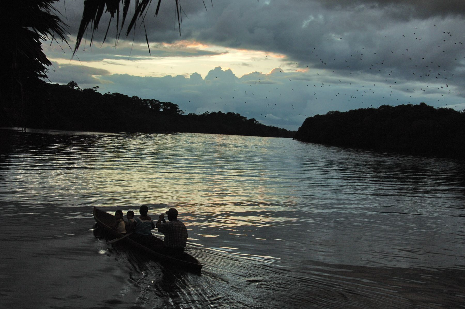 Mayan Family in Guatemala Paddling At Sunset