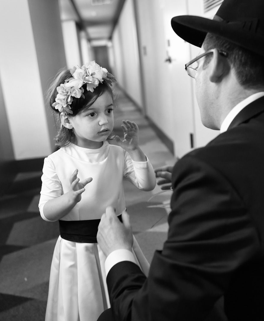 Flower Girl With Garland at an Orthodox Wedding  In Brooklyn