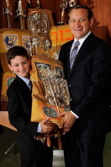 Bar Mitzvah Boy, With The Torah And His Rabbi.