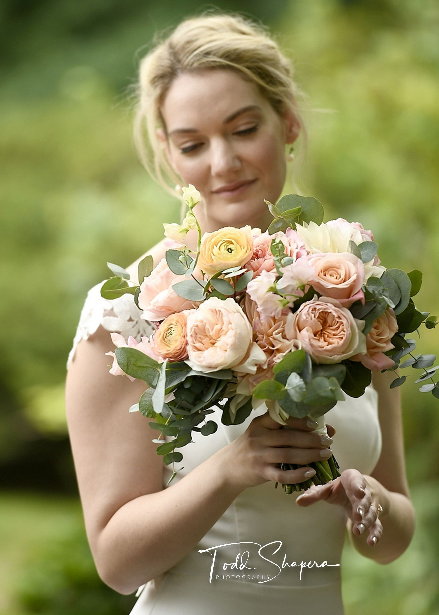 Bride And Her Bouquet Of Roses