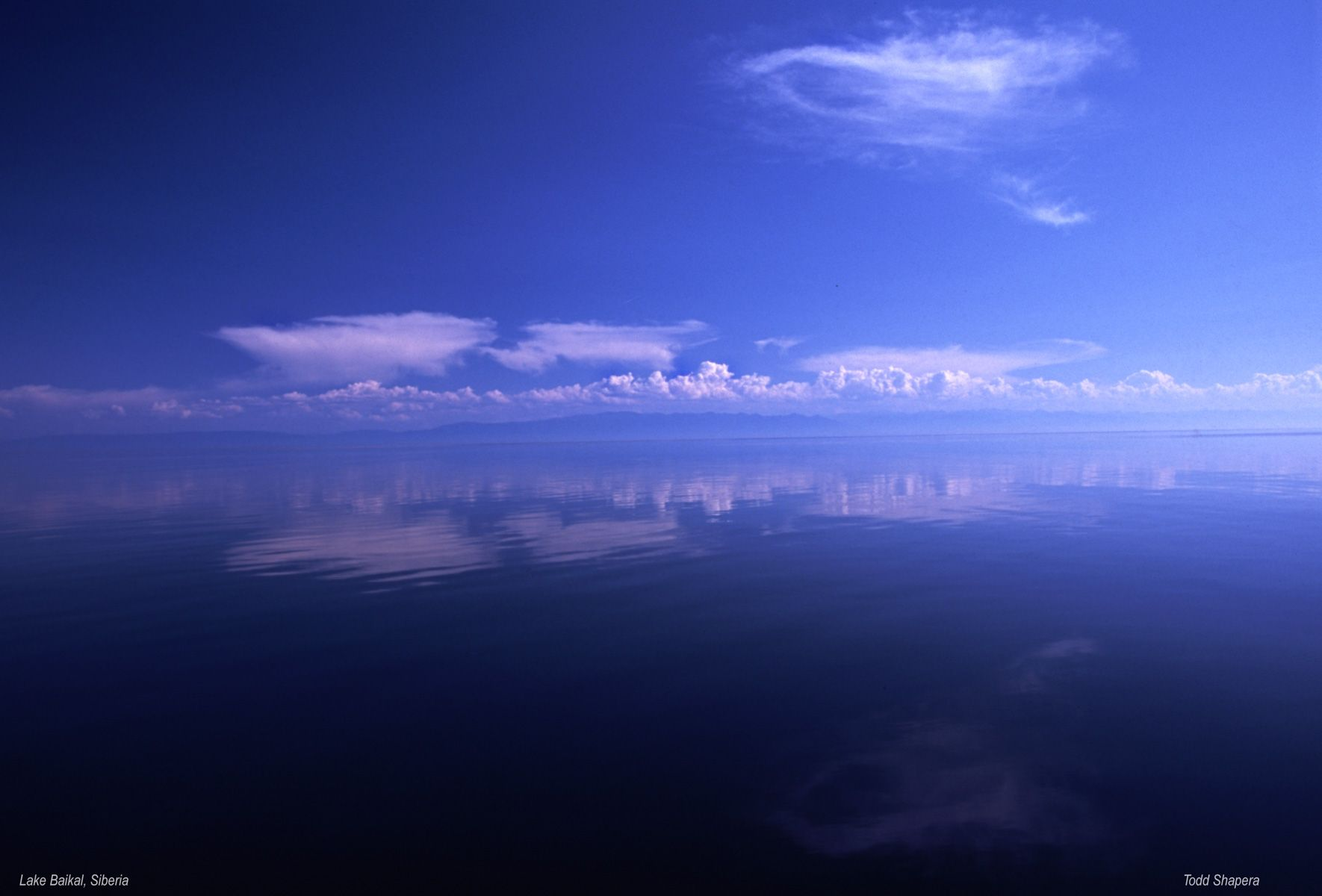 Cloud Reflections On The Siberian Lake