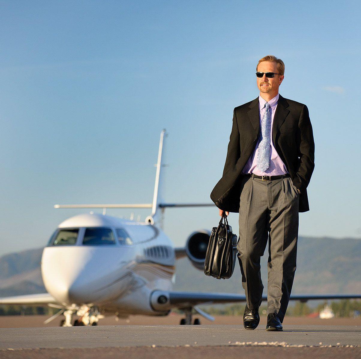 Corporate jet.  Corporate man.  Mountain arena.