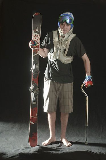 Portrait of a Skier with a Back Brace and cane