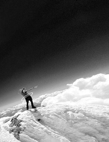 Michael Travis hula-hooping on top of Mt. Shasta
